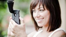 A woman using GoPano camera