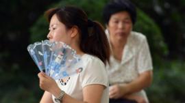 Woman fanning herself