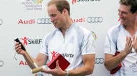 Prince William being presented with a child's polo mallet