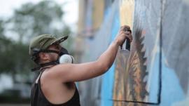 A graffiti artist spraying paint