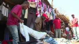People at a second hand clothes market