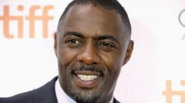 Cast member Idris Elba poses on the red carpet before a screening of the film