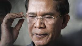 Cambodia's Prime Minister Hun Sen reacts as he speaks to the media during an inspection of a bridge construction site in Phnom Penh July 31