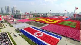 North Korean soldiers and performers participate in a mass military parade to celebrate the 65th anniversary of the countrys founding