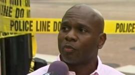 Man speaking to reporter at Washington Navy Yard
