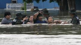 People chest-deep in flood water in Villahermosa, Mexico