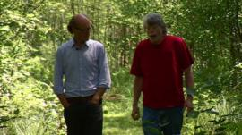 Will Gompertz and Stephen King walking through a wood