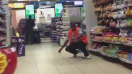 Men inside a supermarket