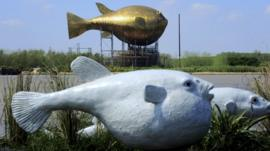 A viewing tower in the shape of a giant copper puffer fish