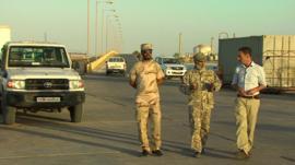 Libyan militiamen with Newsnight's Tim Whewell