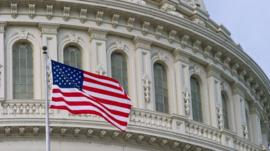 The US Flag flies outside the Capitol