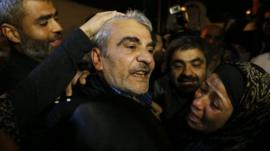One of the freed Lebanese men greeted by jubilant relatives