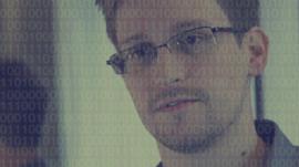 Edward Snowden during interview with data illustration