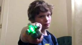 A Doctor Who fan posing with the sonic screwdriver