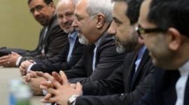 Iranian Foreign Minister Mohammad Javad Zarif, centre, attends talks on Iran's nuclear program in Geneva on Friday Nov. 22, 2013