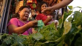 Woman selling food in street market
