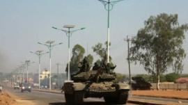 Tank rolls along road in Juba