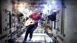 Chris Hadfield in his famous YouTube cover of Space Oddity