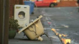 Discarded bath and washing machine on Rhyl street hit by floods in December
