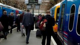 Rail commuters in King's Cross station