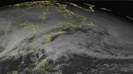 This NOAA satellite image taken Sunday, January 05, 2014 at 01:45 PM EST shows widespread clouds affecting the eastern United States as moisture was surging north ahead of developing low pressure in the Ohio Valley