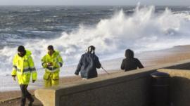 Waves crash onto the beach on Portland, Dorset