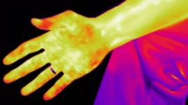 A hand in heat vision