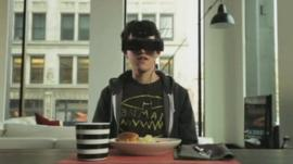 boy sat at a table wearing a headset
