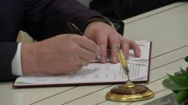 President Yanukovych signing deal