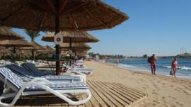 Empty reclining chairs are seen on the beach in the Egyptian Red Sea resort of Sharm el-Sheikh