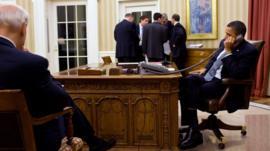 President Barack Obama speakers by phone with Egypt's president Hosni Mubarak