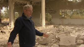 Jim Muir among rubble