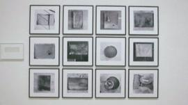 A display of photographs taken by Yoko Ono