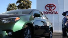 Toyota logo and cars