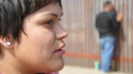Stephany Ramirez at the border fence in Tijuana.