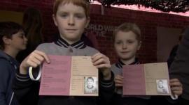 Children with souvenirs at WW1 roadshow