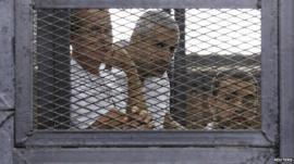 Peter Greste (left), Mohamed Fahmy (centre) and Baher Mohamed