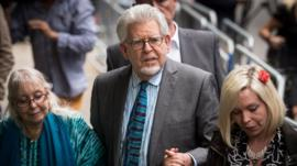 Rolf Harris flanked by his wife Alwen and daughter Bindi