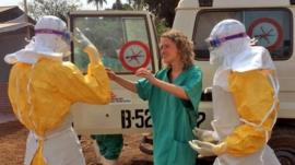 Healthcare workers from Medecins Sans Frontieres in Gueckedou, Guinea - 28 March 2014