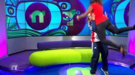 Ayshah being lifted by Rebekah Tiler