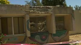Building hit by rocket in Kfar Aza