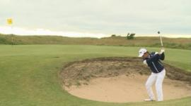Young golfer hit a ball in the bunker at the Junior Open 2014