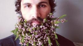 man with flowers in his beard