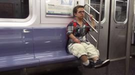 Filmmaker Jonathan Novick sitting on a train in New York