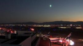 green light in sky over airport