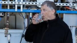Bill Gates drinks a glass of water produced from human waste