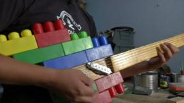 Guitar made of wood and plastic bricks
