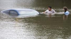 People with submerged car in Texas