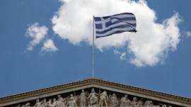 Greek flag on top of Athens Academy building