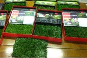 Boxes of artificial turf
